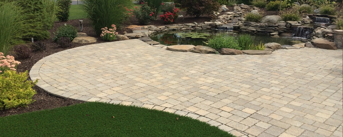 custom paver patio installed for backyard living space