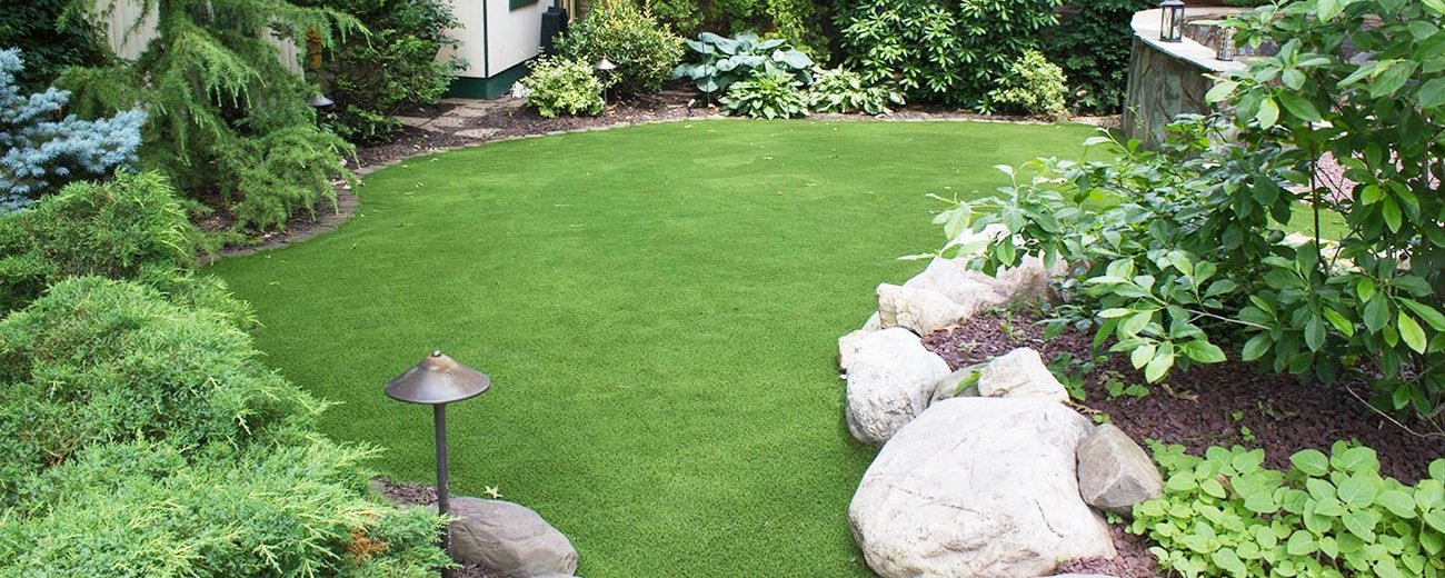 synthetic grass installed for backyard